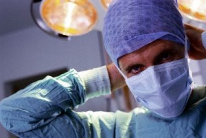 Surgeon Tying Surgical Mask
