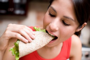 woman-eating-whole-wheat-wrap